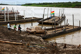 Car boarding raft to cross the River Mamoré between San Ignacio de Moxos and Trinidad , Beni , Bolivia