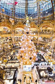 Ornate interior of Lafayette store with Christmas tree, Paris, France