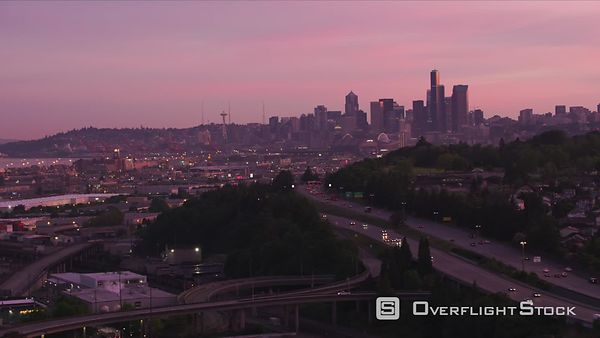 Seattle, Washington Aerial view of freeways and Seattle skyline at sunrise.  Shot with Cineflex and RED EpicW Helium.