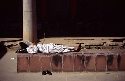 India - Chandigarh - In the middle of the day, an Indian man sleeps