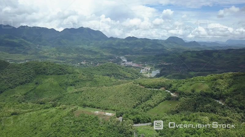 Aerial view of green mountains covered by jungle nearby Xiang Ngeun, filmed by drone, Luang Prabang Province, Laos