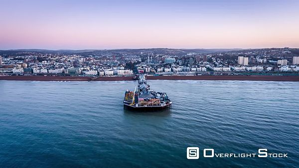 Aerial view of Brighton Pier, Brighton, during sunrise, United Kingdom - filmed by drone
