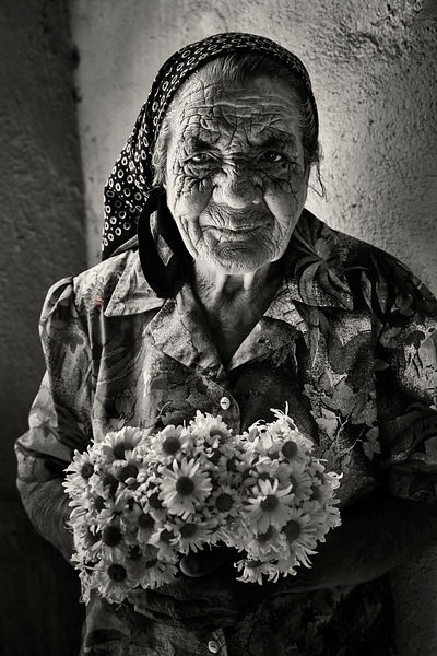 Portrait of a Flower Seller in an Alleyway