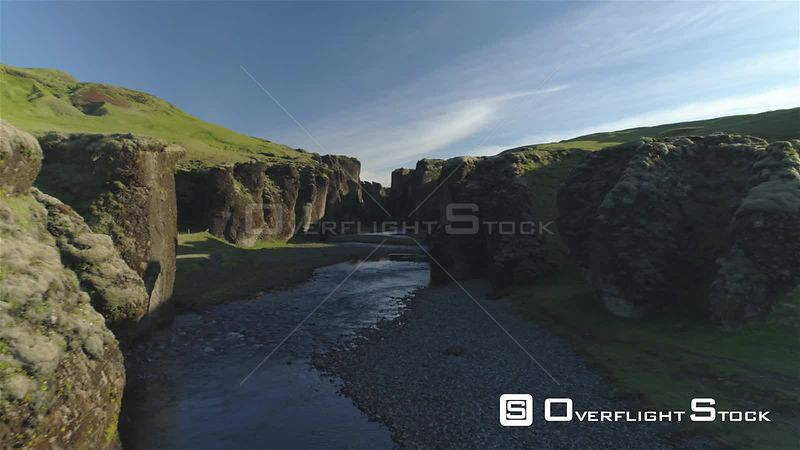 Into Fjadragljufur Glacial River Canyon Iceland, Morning Light Drone Aerial