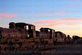 Old steam trains in train cemetery at sunset, Uyuni, Bolivia