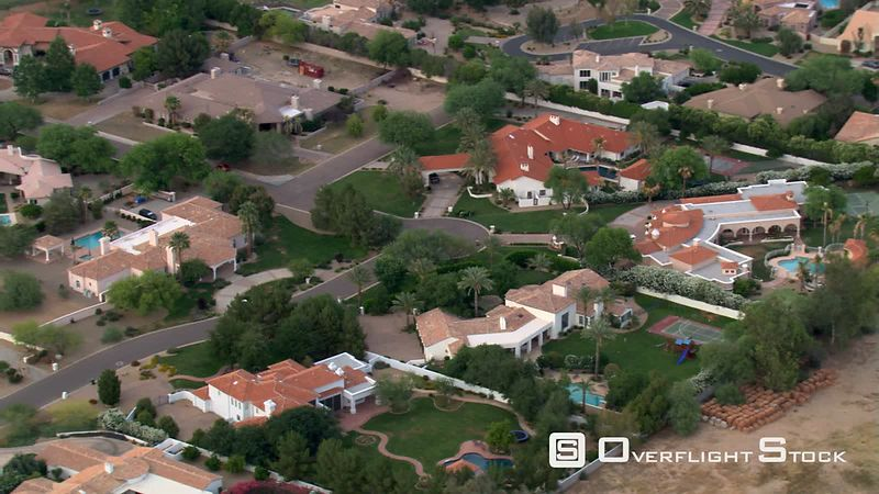 Flight over wealthy Scottsdale residential area bordering a golf course.