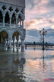 Acqua Alta in St Marks square at sunrise, Venice