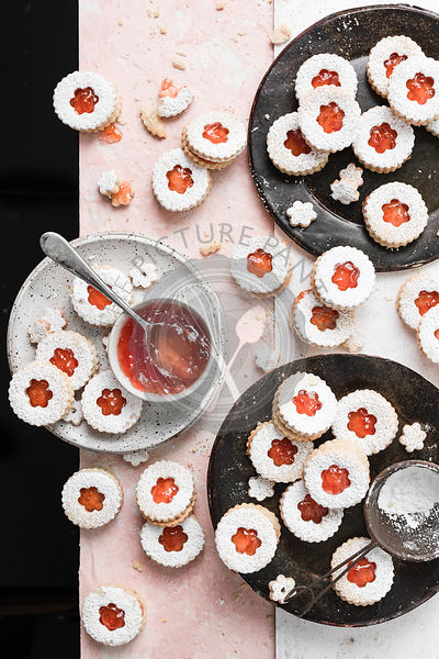 Grapefruit jam filled linzer cookies dusted with powdered sugar.