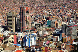 View of city centre and new government palace under construction next to cathedral, Killi Killi viewpoint, La Paz , Bolivia