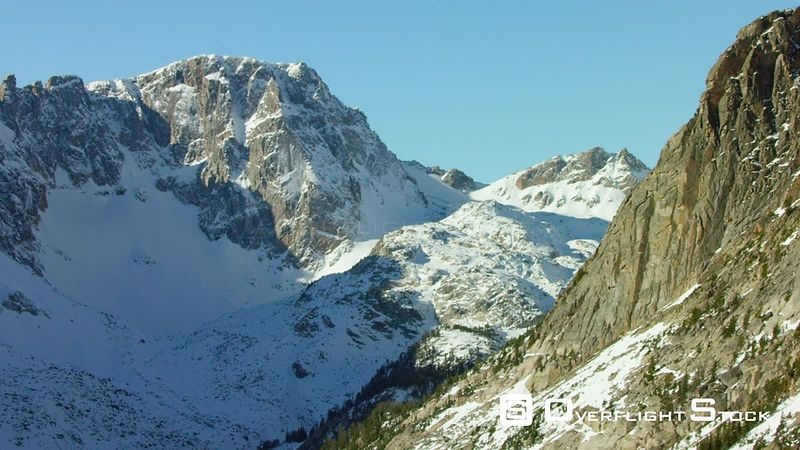 The snowcapped peaks and steep cliffs of the Beartooth Moutnain Range near Yellowstone National Park