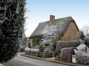Picturesque cottage laden with frost