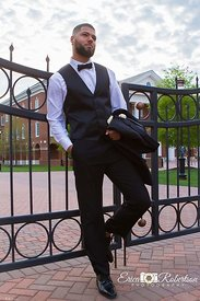 Prom-Guy-Leaning-On-Iron-Fence