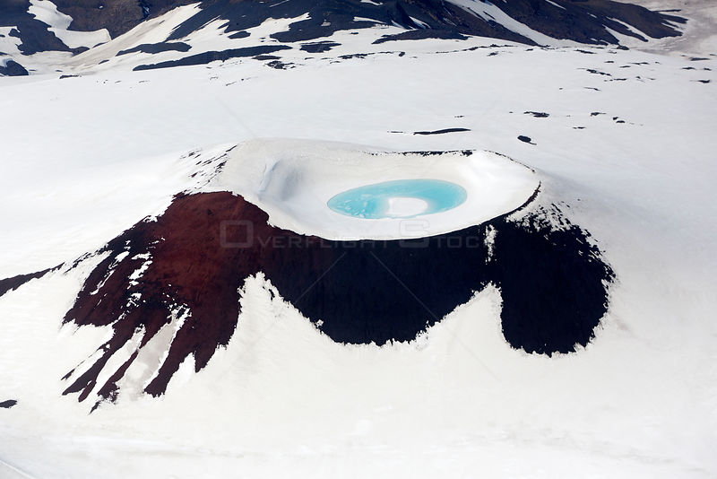 Aerial view of crater lake in snowy mountain, near Landmannalaugar, Iceland, June 2014.
