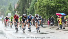 Group of Cyclists Riding in the Rain - Tour de France 2014