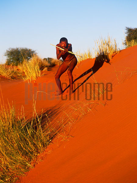 San Hunter Standing on a Sand Dune