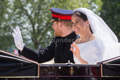 Newlyweds - the Duke and Duchess of Sussex - wave to the crowd in The Long Walk during the carriage ride after their wedding
