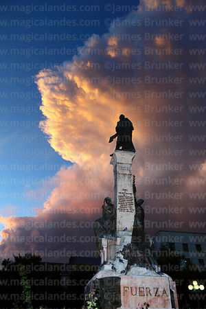 Murillo monument and storm cloud at sunset, Plaza Murillo, La Paz, Bolivia