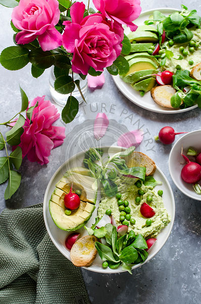 Pea hummus with avocado and radishes