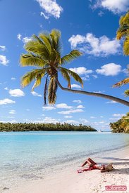 Woman on the beach of One Foot Island, Aitutaki, Cook Islands