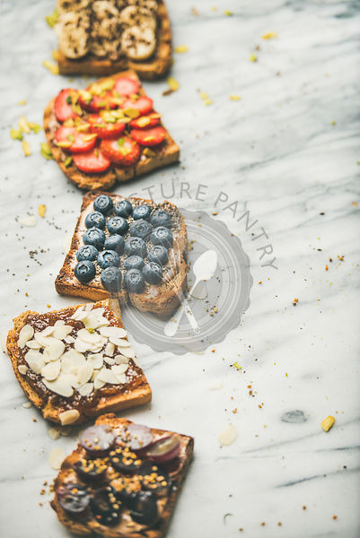 Vegan whole grain toasts with fruit, seeds, nuts