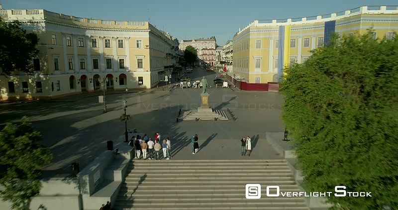Aerial drone camera flies backward and climbs from the Duc Richelieu statue in Odessa Ukraine to reveal the newly refurbished Potemkin Steps Ukraine