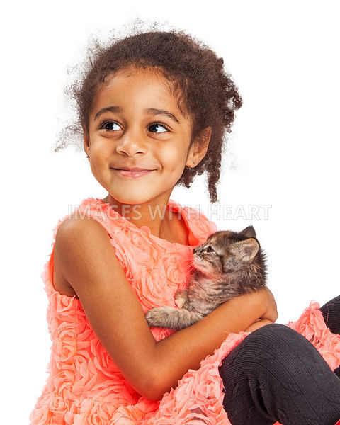 Happy Smiling Girl Holding a Kitten