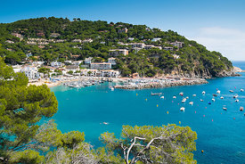 Hillside residences overlook the bay at Llafranc, on the Costa Brava, in Spain