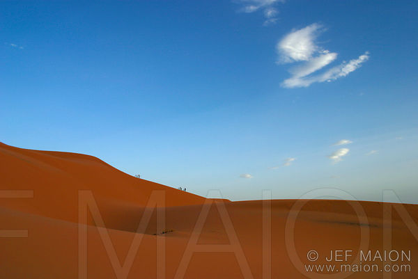 Riding bicycles on a dune in the Sahara images
