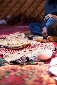 Adult kyrgyz man drinking tea inside a yurt, Xinjiang, China