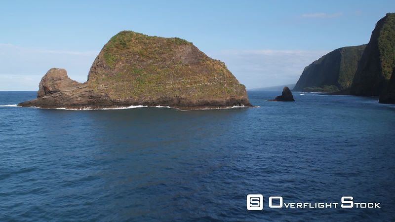 Past island and fin-like sea stack in The Valleys area of Hawaiian coast