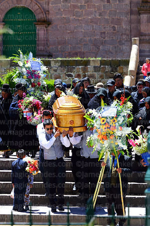 Funeral procession leaving San Pedro church, Plaza de Armas, Juli, Puno Region, Peru