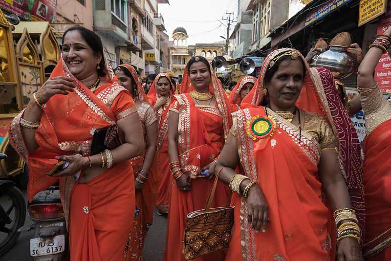 Women Dressed in Orange in a Procession Worshipping the God Ramdev
