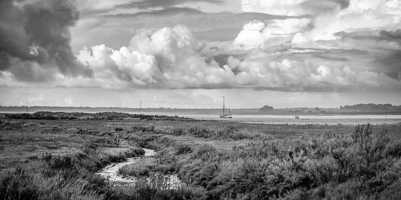 Shower clouds over the Colne Estuary BW