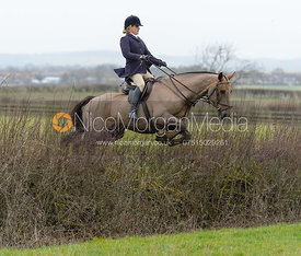 Laura Winkler jumping a hedge at Sheepwash - The Belvoir at Mount Pleasant
