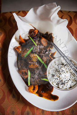 Asian dish - beef in black pepper sauce, with rice, shot on vintage chair