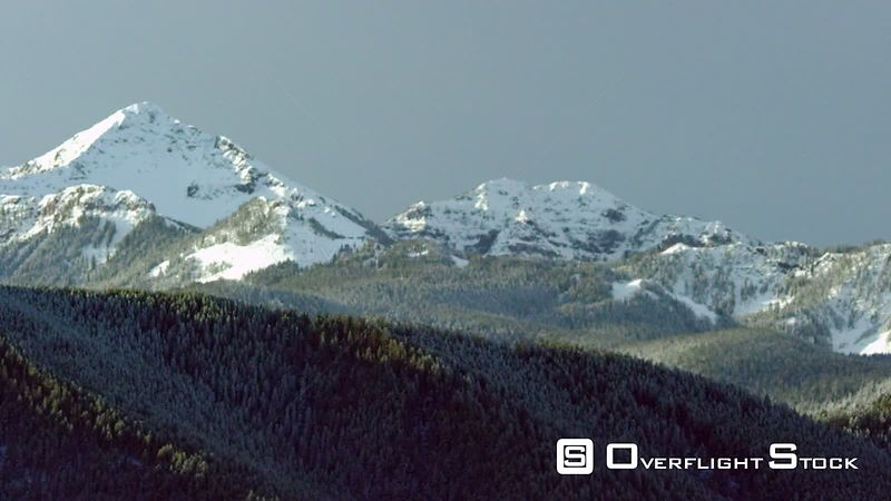 Snowcapped peaks and dense forest in the Gallatin mountain Range near Bozeman, Montana