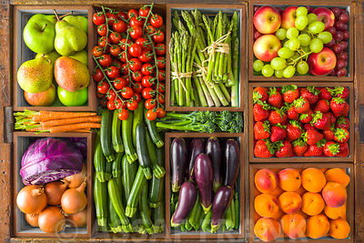 Fruit and vegetables in in wooden boxes