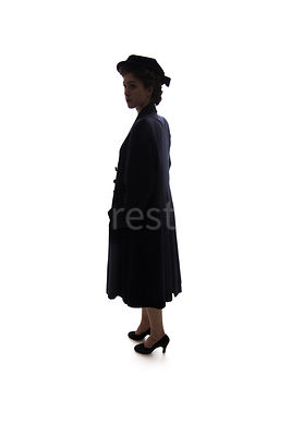 A silhouette of a 1940's woman in a hat and a coat – shot from eye-level.