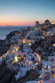 Romantic sunset over the village of Oia, Greece, Santorini