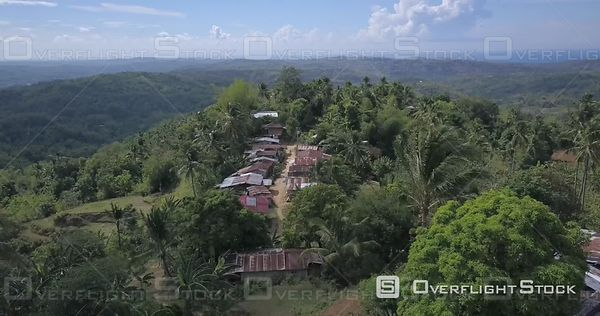 Buenavista Village with simple houses near Igbaras Town in Panay Island, Drone Video Philippines.