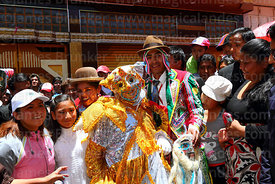 The pepino poses for photos with spectators during events for the Desentierro del Pepino, La Paz, Bolivia