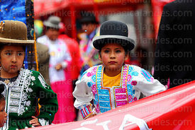 Young cholitas dancing during parades for the Entierro del Pepino, La Paz, Bolivia