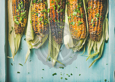 Grilled sweet corn with pesto sauce and herb, copy space