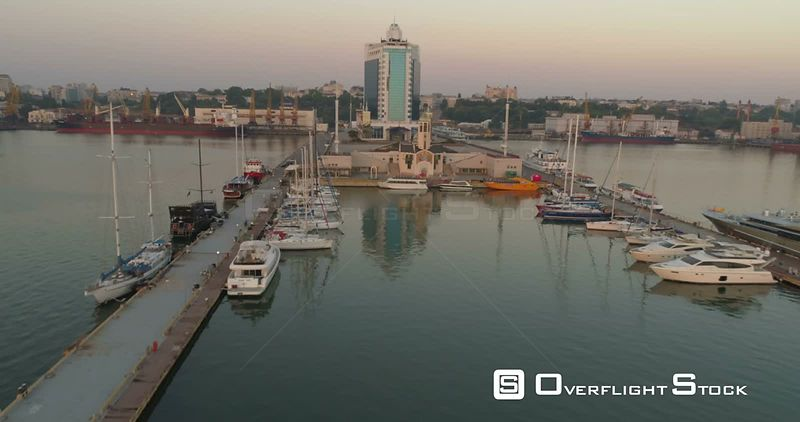 Drone rises over the marina at Odessa cruise terminal to reveal the city skyline.  Ukraine