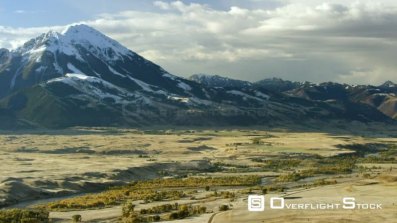 The Absaroka mountains tower above the Paradise Valley and Yellowstone river in a color filled Montana autumn