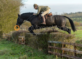 Bruce Langley McKim jumping a hedge on Deane Bank