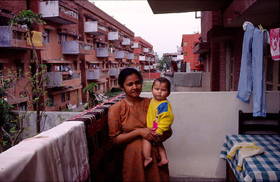 India - Chandigarh - A woman and her child at home in a modern apartment Chandigarh
