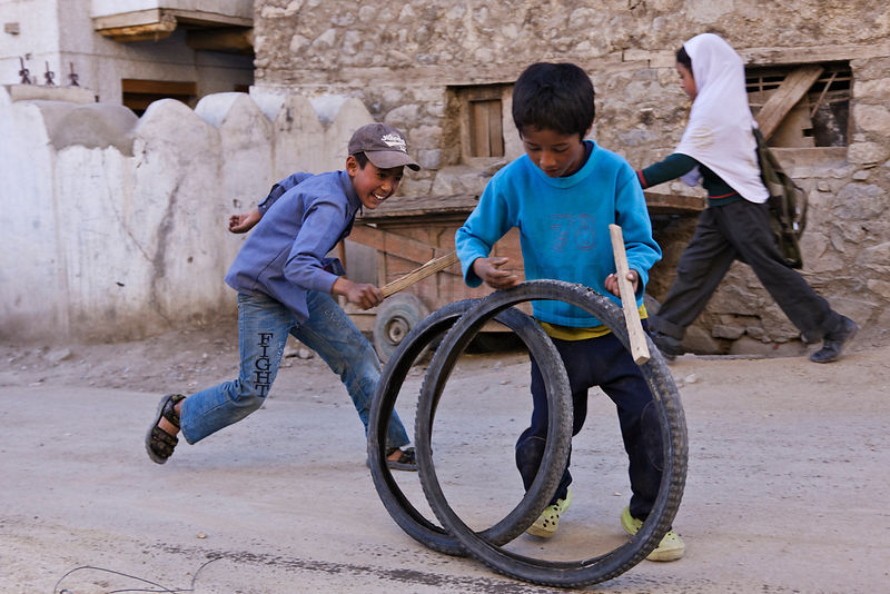 Young Boys Playing with Bicycle tyres