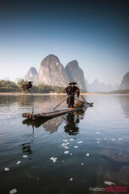 Old chinese fisherman with cormorants, China