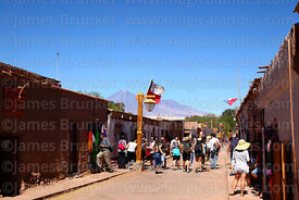 Tourists in Caracoles street, Licancabur volcano in background, San Pedro de Atacama, Region II, Chile